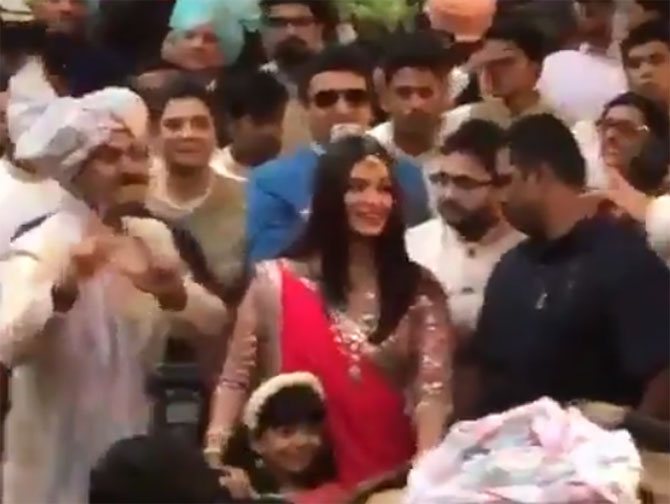 Aishwarya Rai Bachchan and daughter Aaradhya do 'bhangra' at family friend's wedding in Mumbai